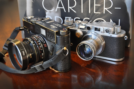 Two generations of Leica: IIIb and its younger sister, a M6TTL Millennium, together with Clément Chéroux's book, Henri Cartier-Bresson Here and Now.